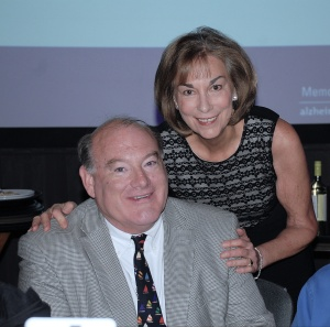 Linda Mitchell, Association CEO and Art Auction Steering Committee Chair Tom O'Donnell share a moment after hearing the total raised exceed expectations at more than $250,000.